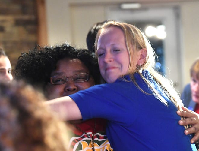 Candidate Jennifer Lewis hugs a supporterer while making the rounds after arriving at an election night watch party in Waynesboro on Tuesday, Nov. 6, 2018.