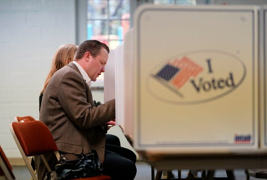 Virginia Republican senatorial candidate Corey Stewart votes at St. Margaret's Episcopal Church in Woodbridge, Va., Tuesday, Nov. 6, 2018.