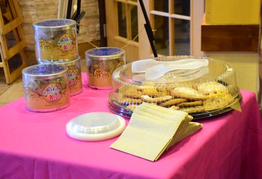 """Tins of cookies from """"Baking Memories 4 Kids"""" and a tray of cookies from Panera Bread of Waynesboro await Raegan Fitzgerald of Staunton and her family at Panera Bread on Tuesday, Nov. 6, 2018. The charity gave the cancer-stricken teen a one-week, all-expenses-paid vacation to the theme parks in Orlando, Fla."""