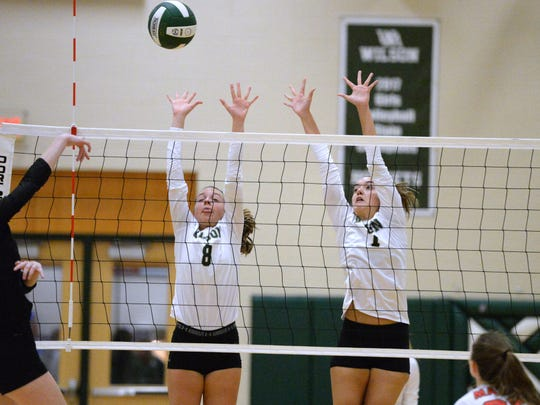 Wilson Memorial's Eliza Dana (8) and Olivia Bower try to block a shot by a George Mason player Tuesday night.