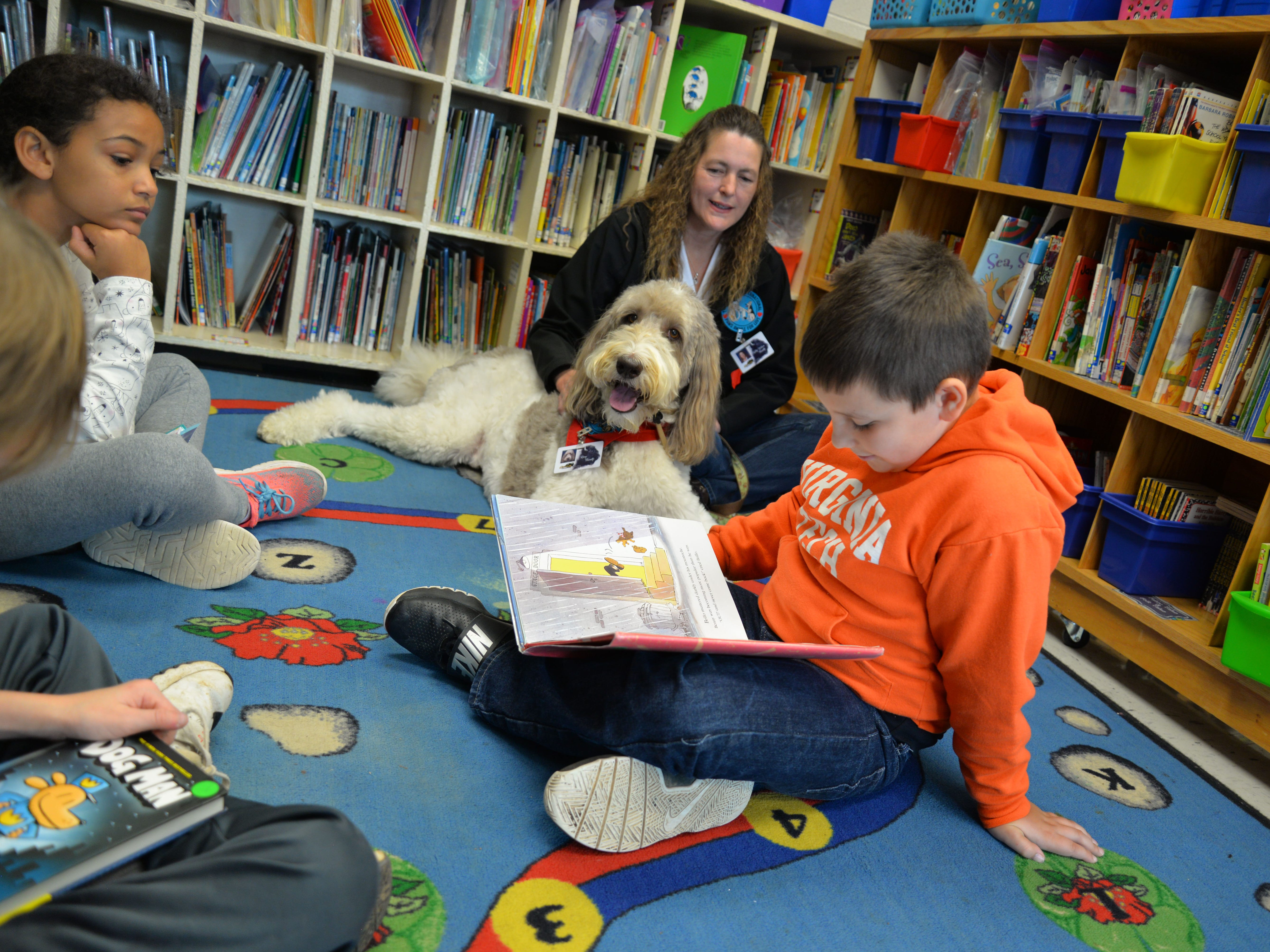 Kathleen Wilson and her labradoodle, Rory, visit Churchville Elementary once a week so students can read to the dog. Rory is a certified therapy dog and is allowed in any Augusta County School or school function. Here Rory is pictured with Mason Abshirine, 9 years old.