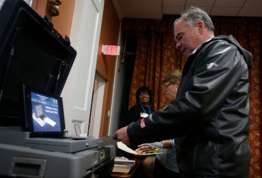 Sen. Tim Kaine, D-Va., feeds his ballot into the vote counting machine as he votes in Richmond, Va., Tuesday, Nov. 6, 2018. Kaine is running against Republican Corey Stewart.