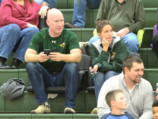 Chris and Heather Davis watch Wilson Memorial's volleyball match Tuesday night. Their daughter, Cassidy, didn't play after tearing her ACL the week before.