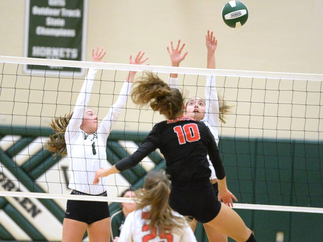 Wilson Memorial's Bella Capriotti (1) and Olivia Bower go up for the block attempt on George Mason's Roza Gal (10) Tuesday night.
