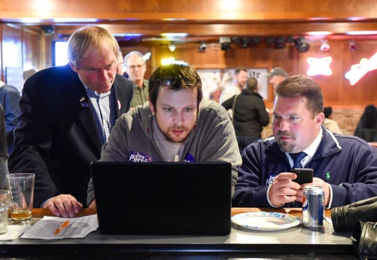 State Senate candidate Joe Perske watches results with volunteers Alex Briner and Chad Hobot Tuesday, Nov. 6, at the La Playette in St. Joseph.