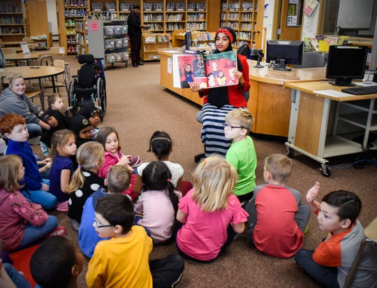 "Habso Mohamud reads her book ""It Only Takes One Yes"" Wednesday, Nov. 7, to students at Madison Elementary School."