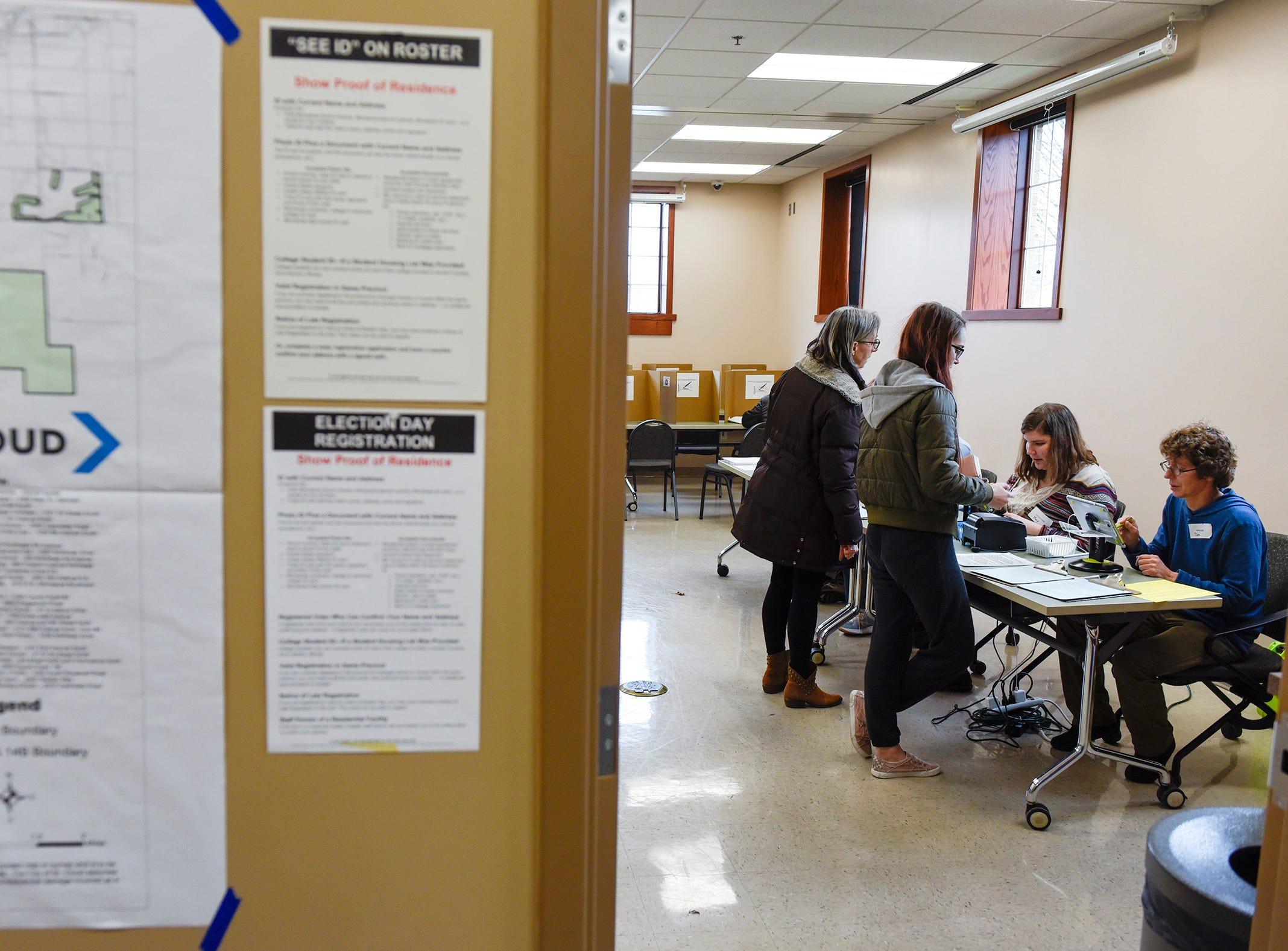Voters check in with election judges to get their ballots Tuesday, Nov. 6, Lake George Municipal Complex in St. Cloud.