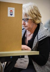 Kris Kennedy fills out her ballot Tuesday, Nov. 6, Lake George Municipal Complex in St. Cloud.