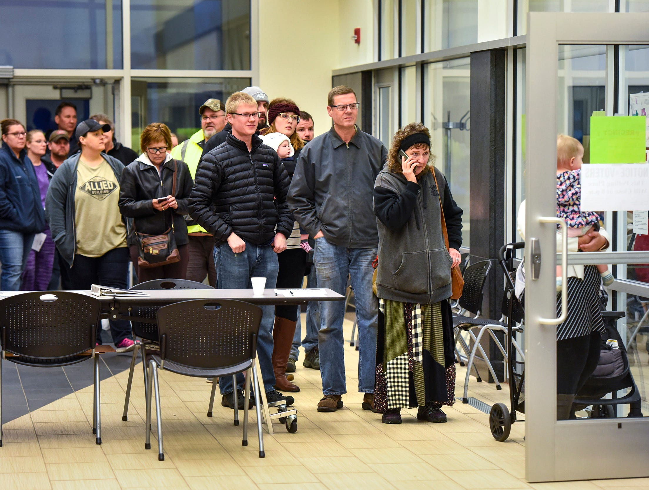 People wait in line to vote Tuesday, Nov. 6, at the Sauk Rapids Government Center.