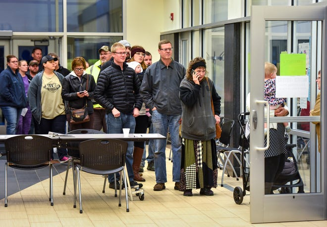 People wait in line to vote Tuesday, Nov. 6, at the Sauk Rapids Government Center. In the Sauk Rapids- Rice school board race, the winners were Lisa Loidolt with 3,331 votes, Robyn Holthausat 3,179 votes and Lisa Braun at 3,081 votes.