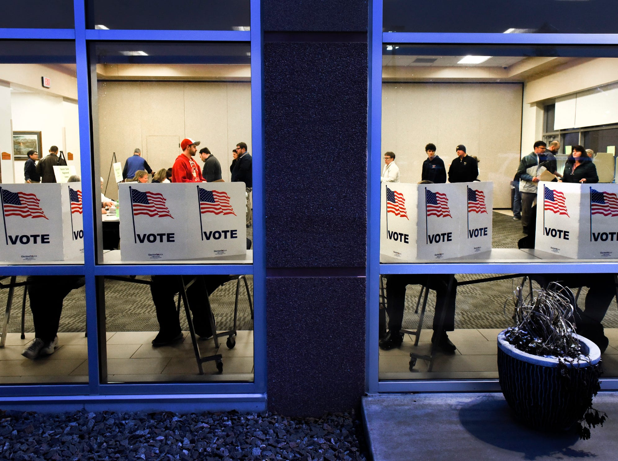 Voters wait for an open seat to fill out their ballots Tuesday, Nov. 6, at the Sauk Rapids Government Center.