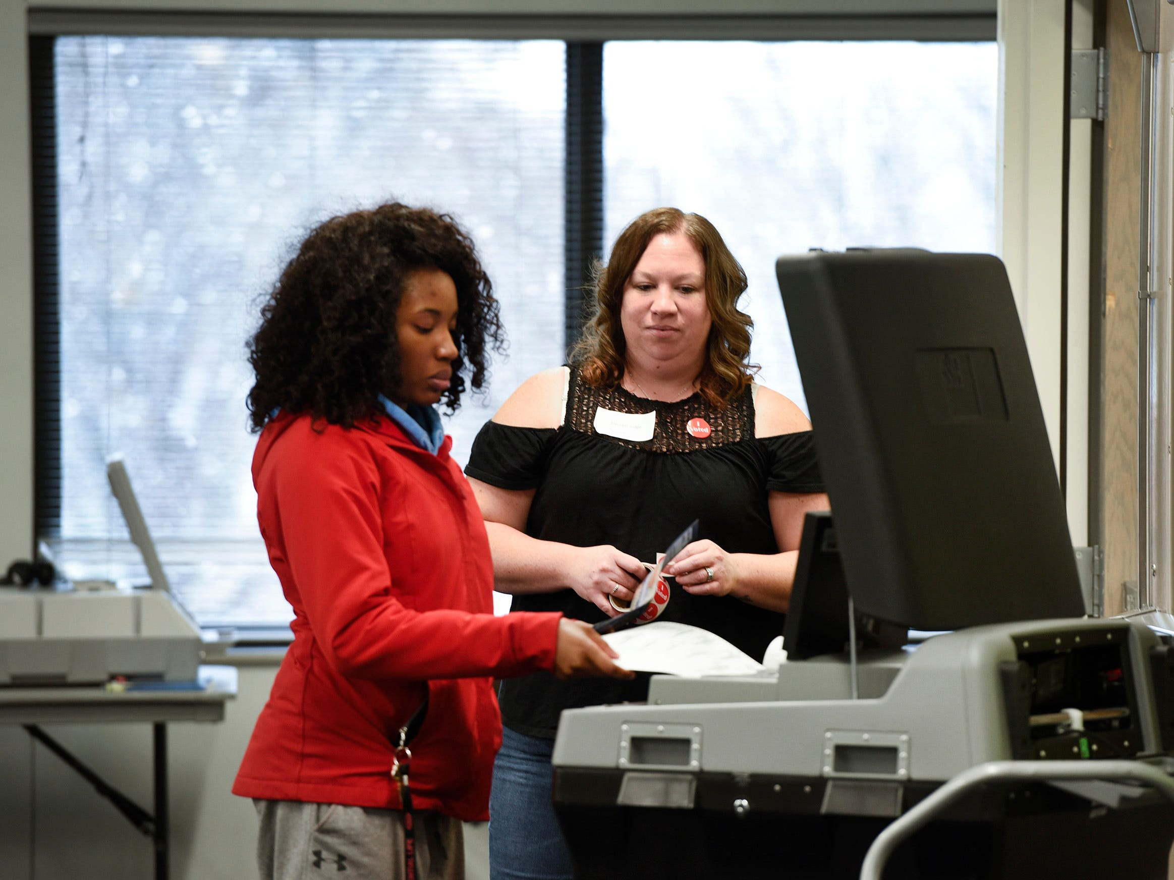 St. Cloud State University student Ellen Nouneu gets her ballot counted Tuesday, Nov. 6, in Atwood Memorial Center as election judge Susan Frank-Perez watches.