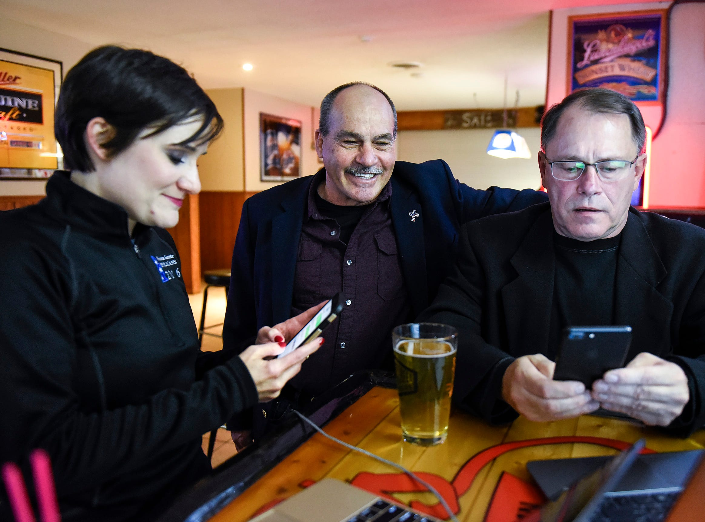 State Rep. Jeff Howe, center, watches the results of his State Senate race with Rachel Aplikowski and Mike Campbell Tuesday, Nov. 6, at Sal's Bar & Grill in St. Joseph.