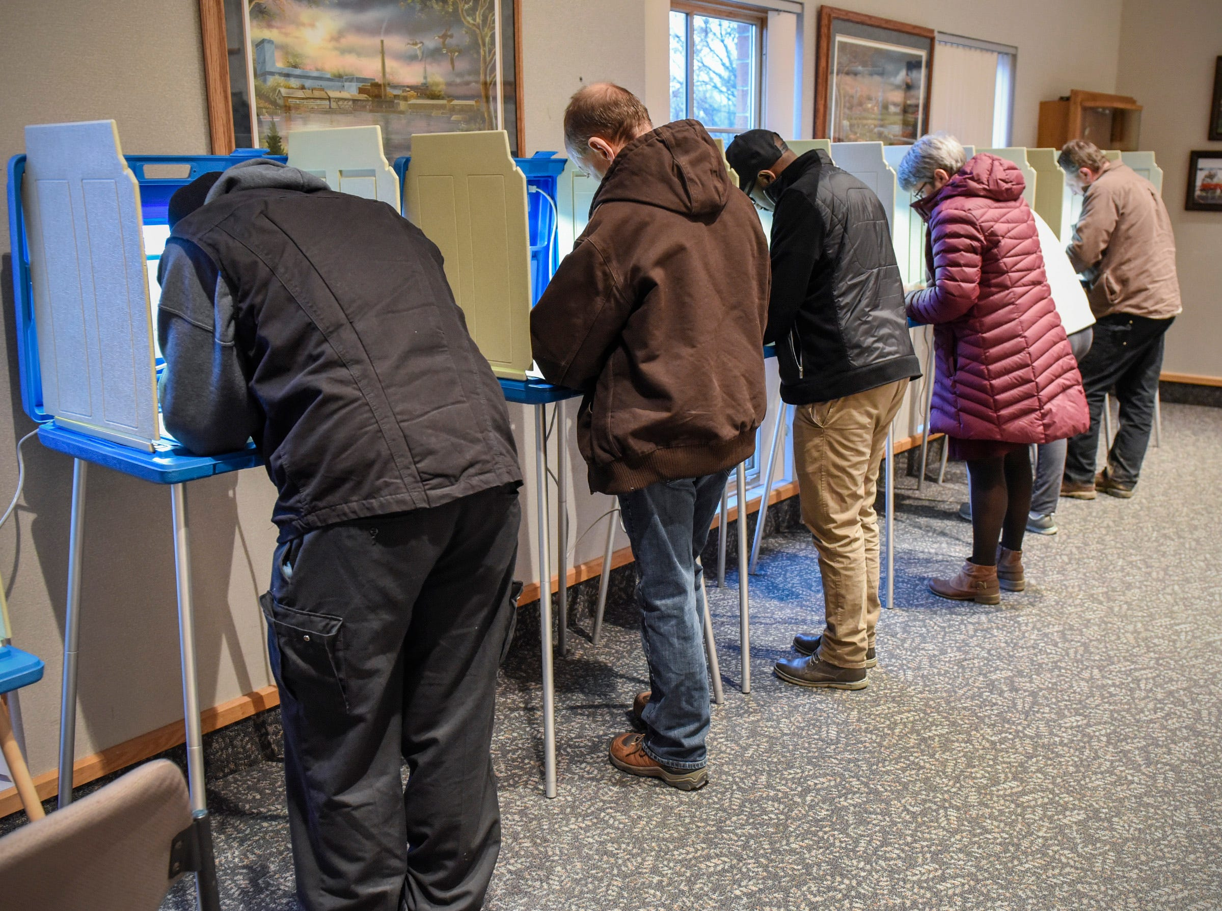 Voters fill out their ballots Tuesday, Nov. 6, at the Sartell City Hall.