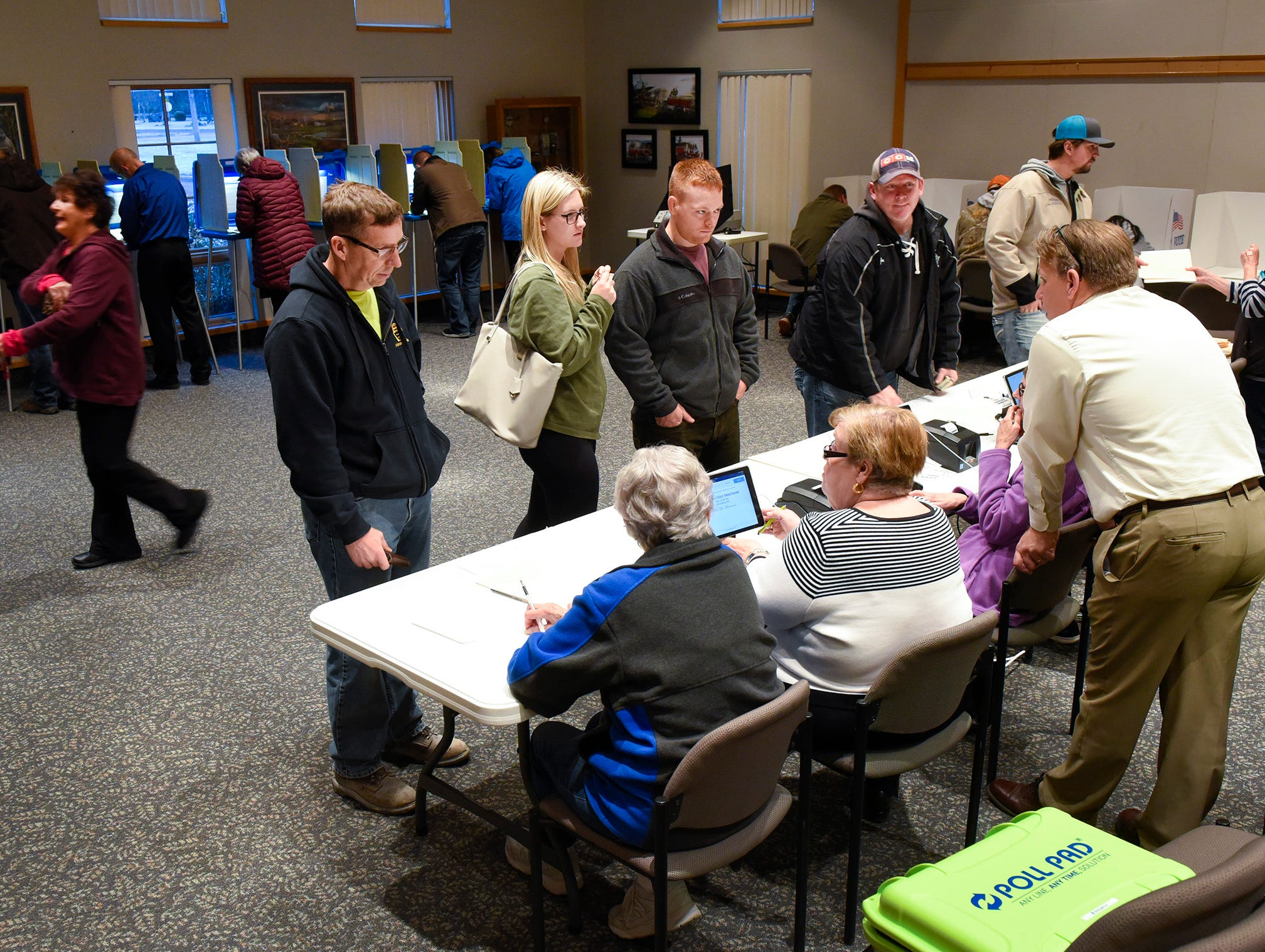 Voters register with judges then fill out their ballots Tuesday, Nov. 6, at the Sartell City Hall.