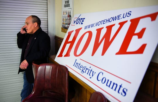 State Rep. Jeff Howe finds a quiet spot to talk on the phone as results come in for his State Senate race Tuesday, Nov. 6, at Sal's Bar & Grill in St. Joseph.