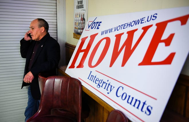 State Rep. Jeff Howe finds a quiet spot to talk on the phone as results come in for his State Senate race in November 2018, at Sal's Bar & Grill in St. Joseph.