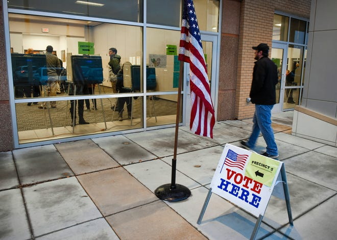 Voters arrive to cast their ballots Tuesday, Nov. 6, at the Sauk Rapids Government Center.