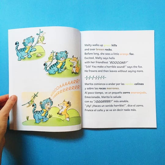 """A page from """"Malty the Blue Tiger"""" by Kelsey Kloss, showing the bolding and colored-word technique that Kloss said helps children make easier associations between the languages."""