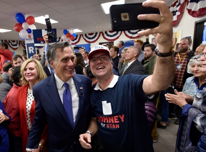Mitt Romney, Republican U.S. senator-elect from Utah, poses for a photo with a supporter at an election night party after his victory Tuesday, Nov. 6, 2018, in Orem.
