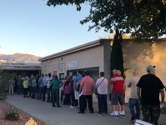 Voters line up at a polling location in Mesquite on Election Day, Nov. 6, 2018.