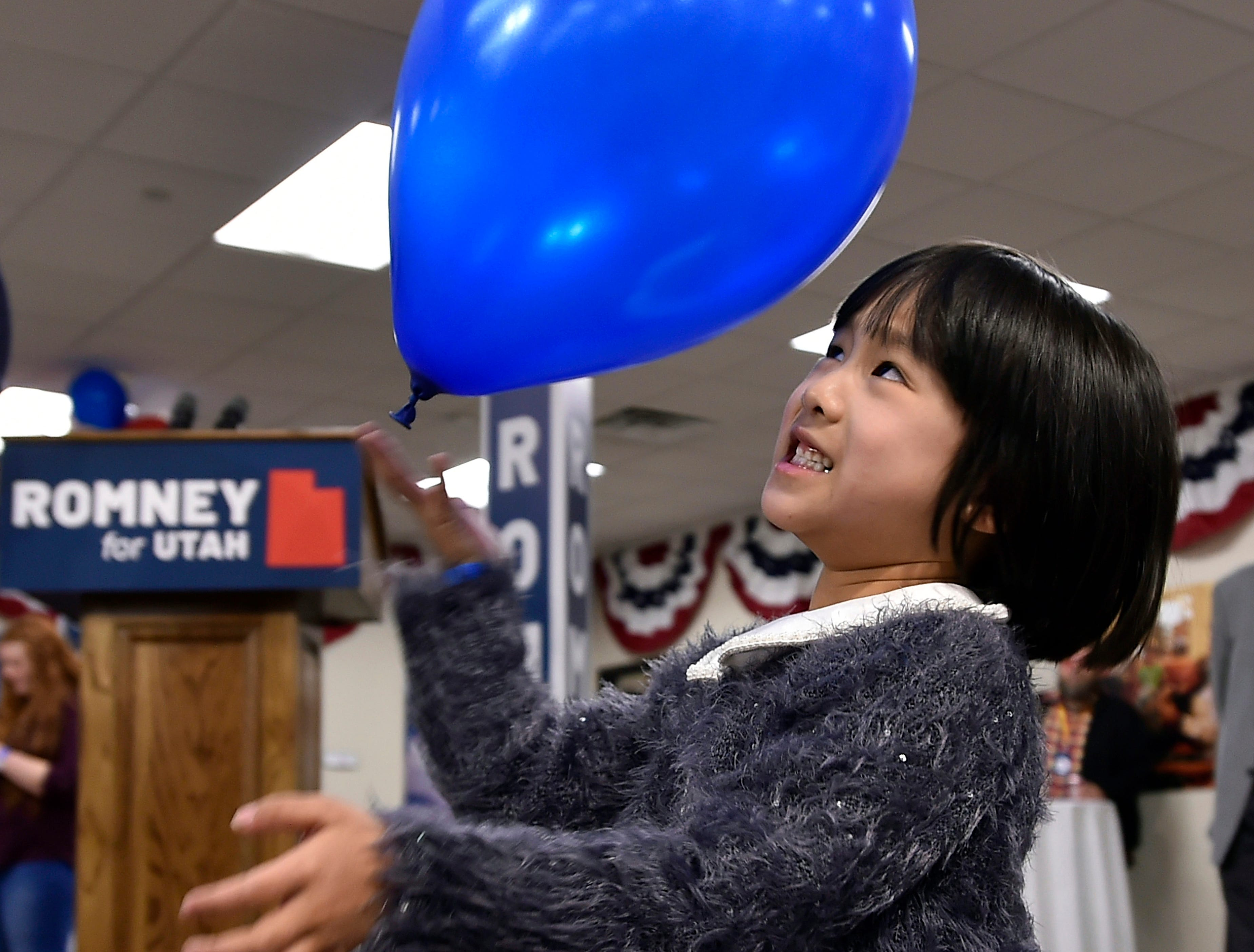 Annabelle Shaw, 5, plays while her parents who are supporters of Utah Republican U.S. Senate candidate Mitt Romney, await word on election results at a gathering in Orem on Tuesday, Nov 6, 2018.