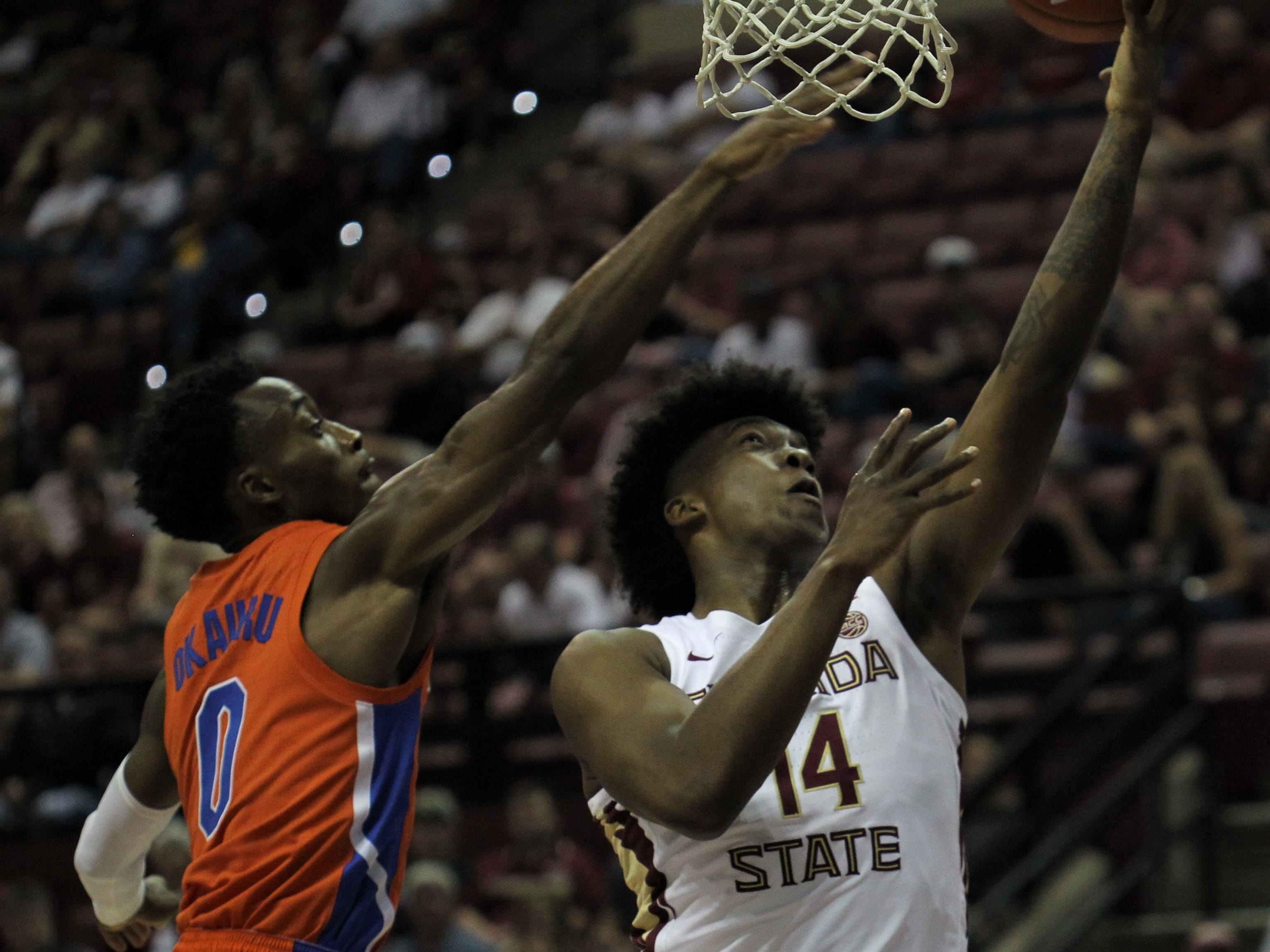 Florida State's Terance Mann goes up for a layup as Florida's Mike Okauru contests during the Sunshine Showdown game Tuesday at the Tucker Civic Center.