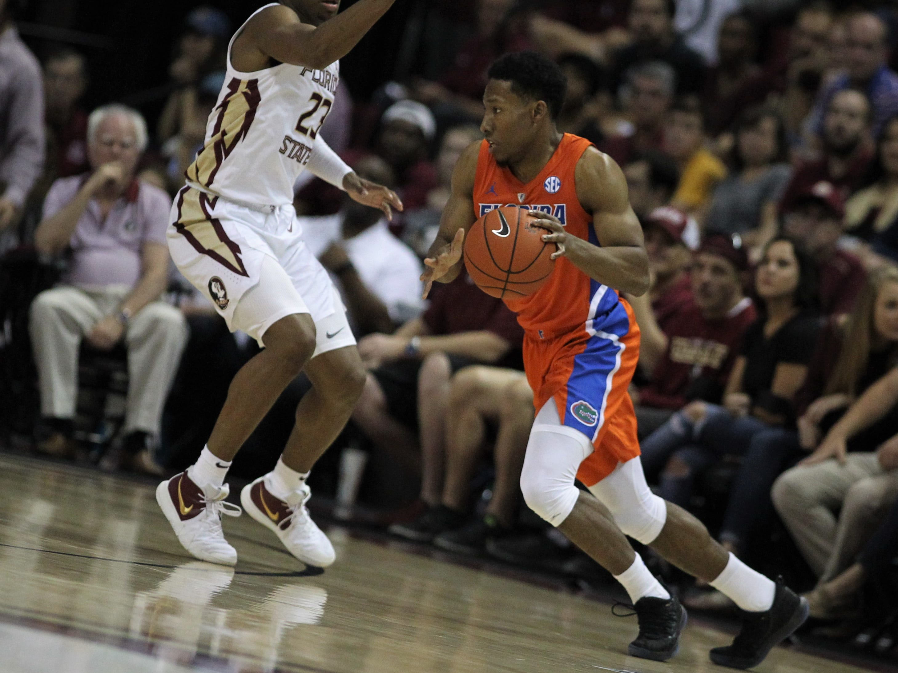 Florida's Jalen Hudson drives against Florida State's M.J. Walker during the Sunshine Showdown game Tuesday at the Tucker Civic Center.