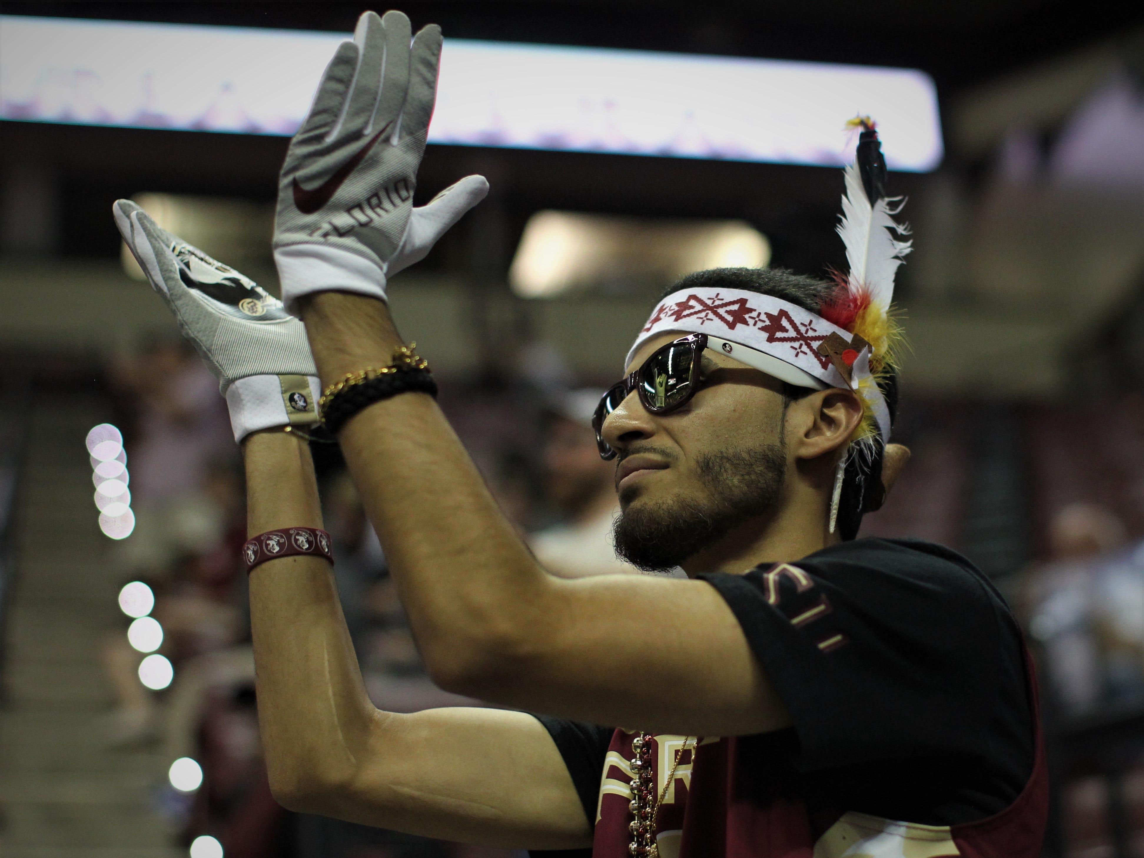 An FSU fan cheers a blowout win over Florida during the Sunshine Showdown game Tuesday at the Tucker Civic Center.