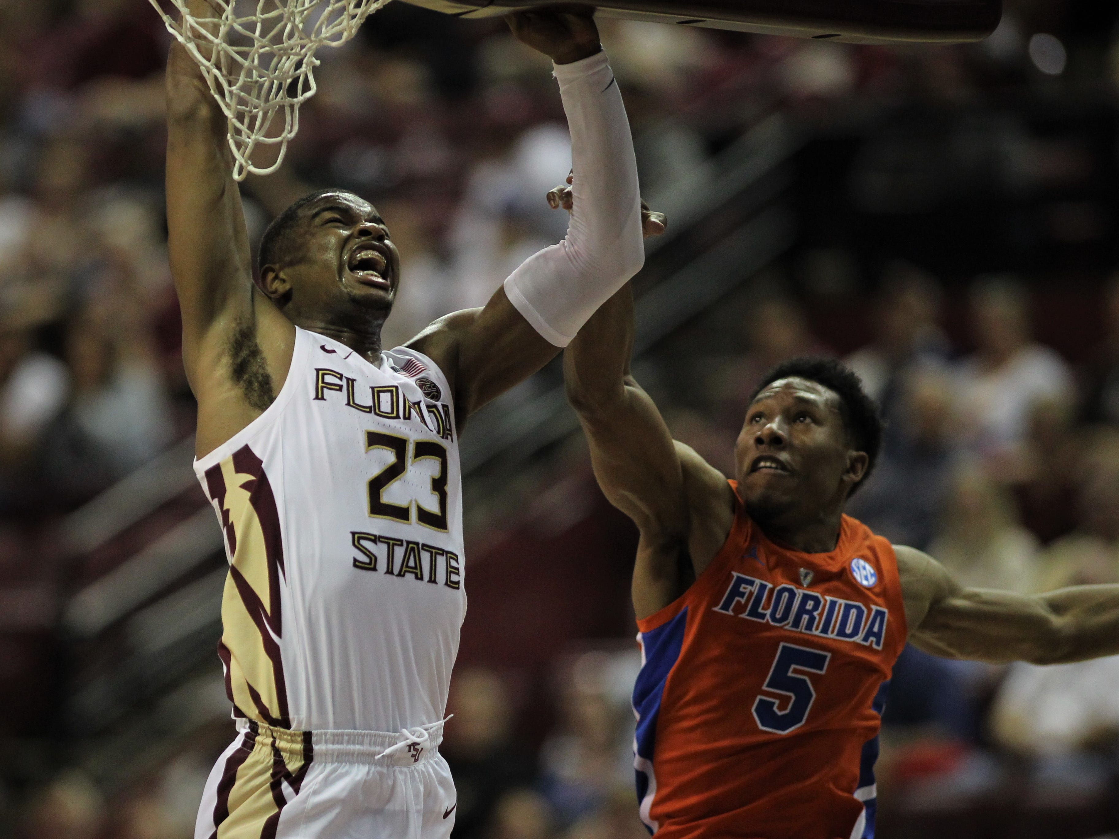 Florida State's M.J. Walker is fouled by Florida's Kevaughn Allen on a layup during the Sunshine Showdown game Tuesday at the Tucker Civic Center.