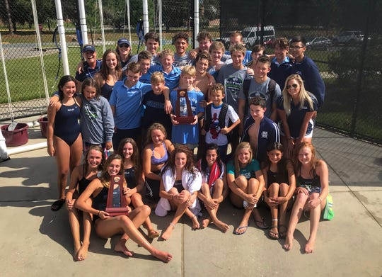 Maclay's girls and boys swimming teams celebrate District 1-1A titles last week at Morcom Aquatics Center.