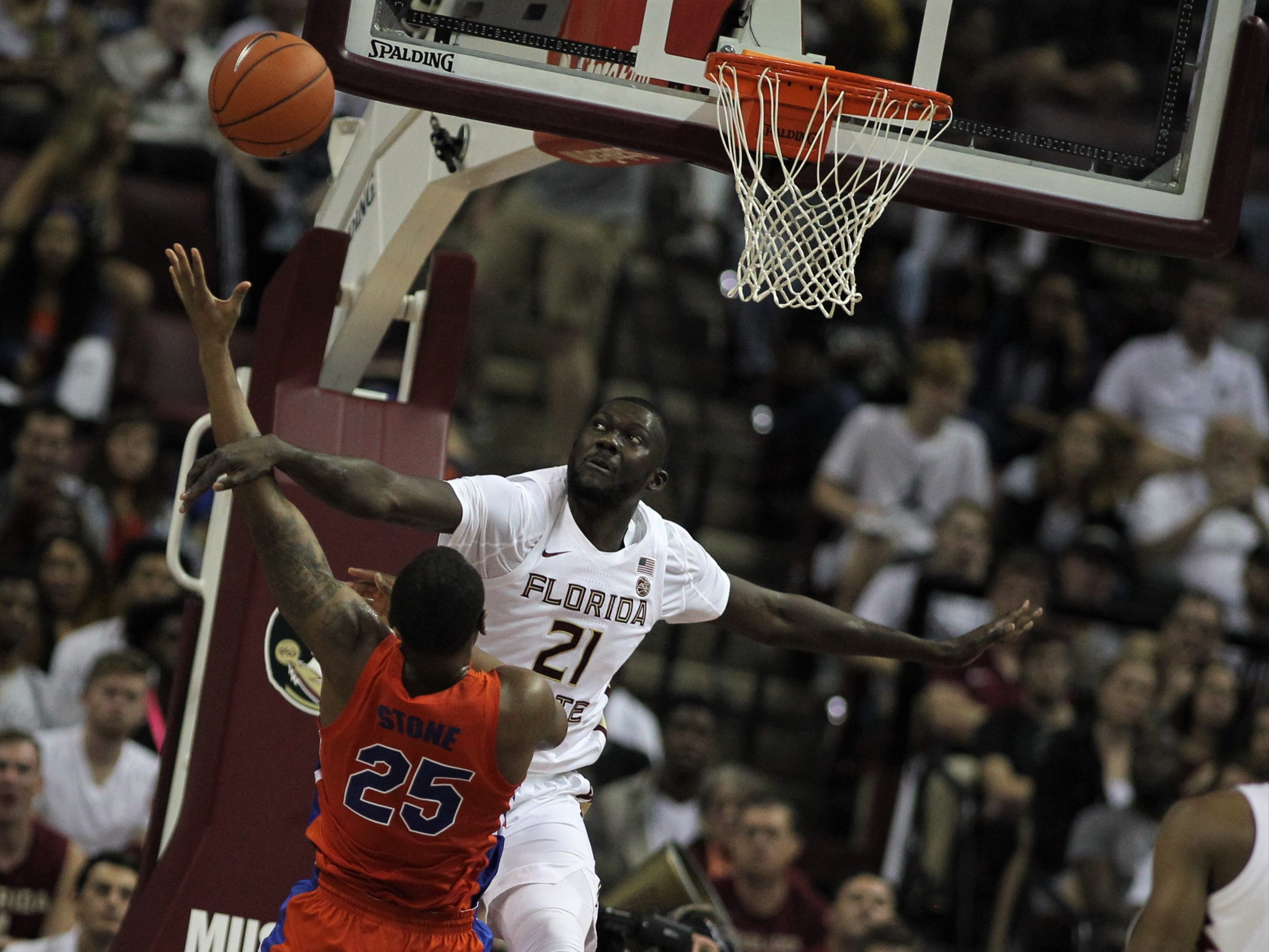 Florida State center Christ Koumadje blocks the shot of Florida's Isaiah Stokes during the Sunshine Showdown game Tuesday at the Tucker Civic Center.
