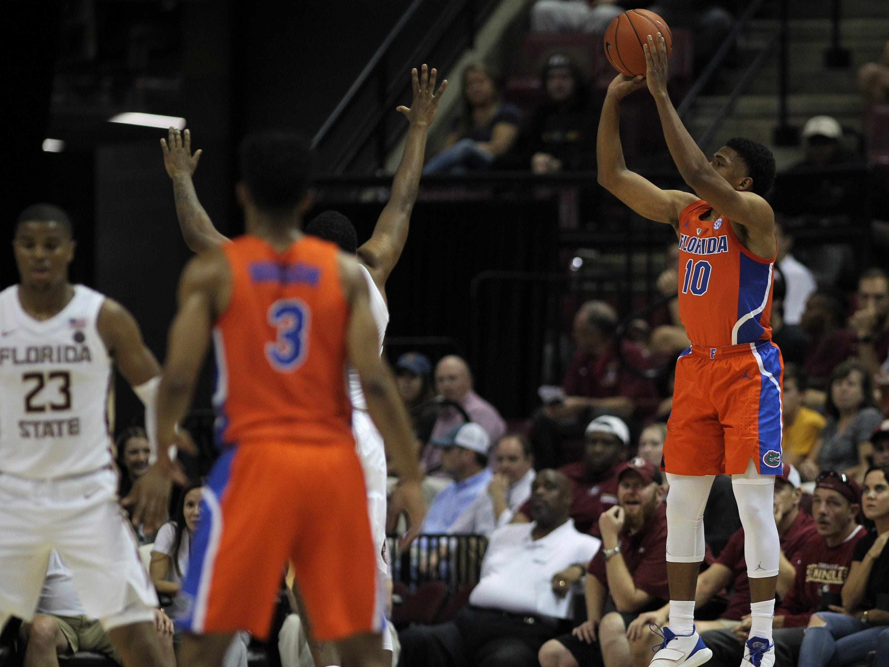 Florida's Noah Locke shoots a 3-pointer against FSU during the Sunshine Showdown game Tuesday at the Tucker Civic Center.