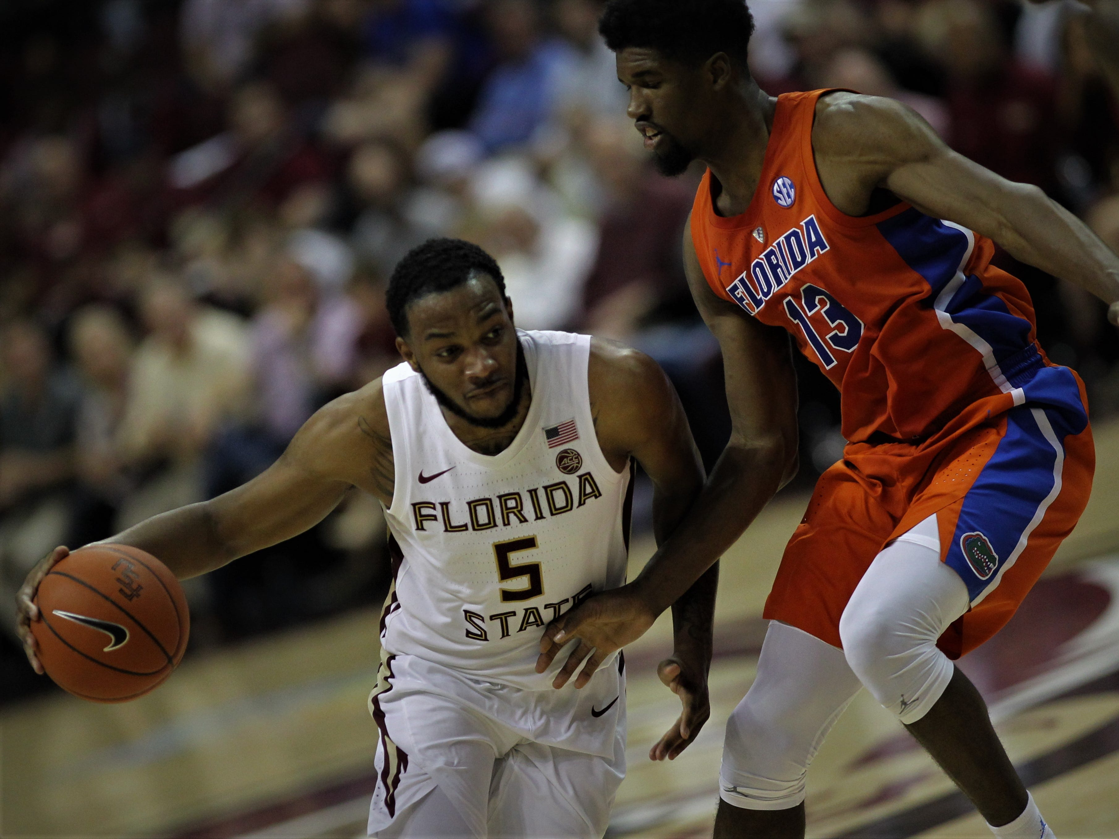 Florida State guard P.J. Savoy drives past Florida's Kevarrius Hayes during the Sunshine Showdown game Tuesday at the Tucker Civic Center.