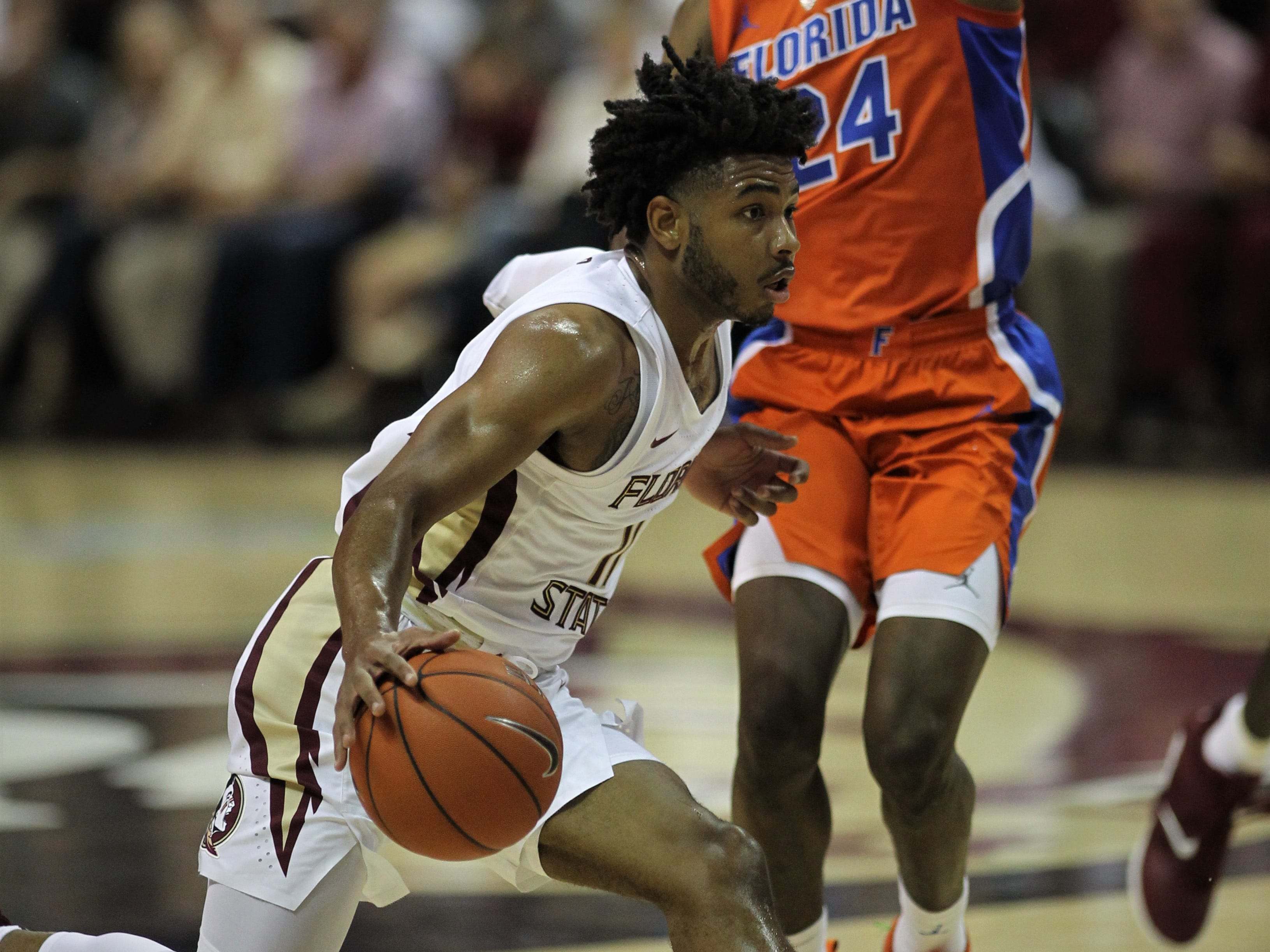 Florida State's David Nichols drives on Florida's Daundrae Ballard during the Sunshine Showdown game Tuesday at the Tucker Civic Center.