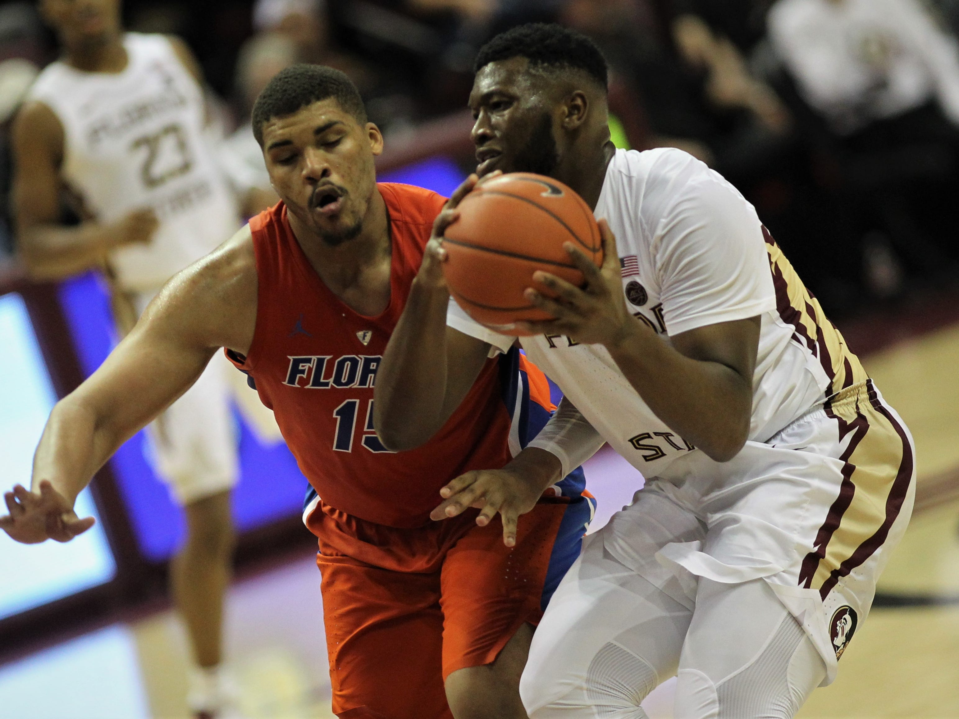 Florida State freshman Raiquan Gray pump fakes in the paint against Florida during the Sunshine Showdown game Tuesday at the Tucker Civic Center.