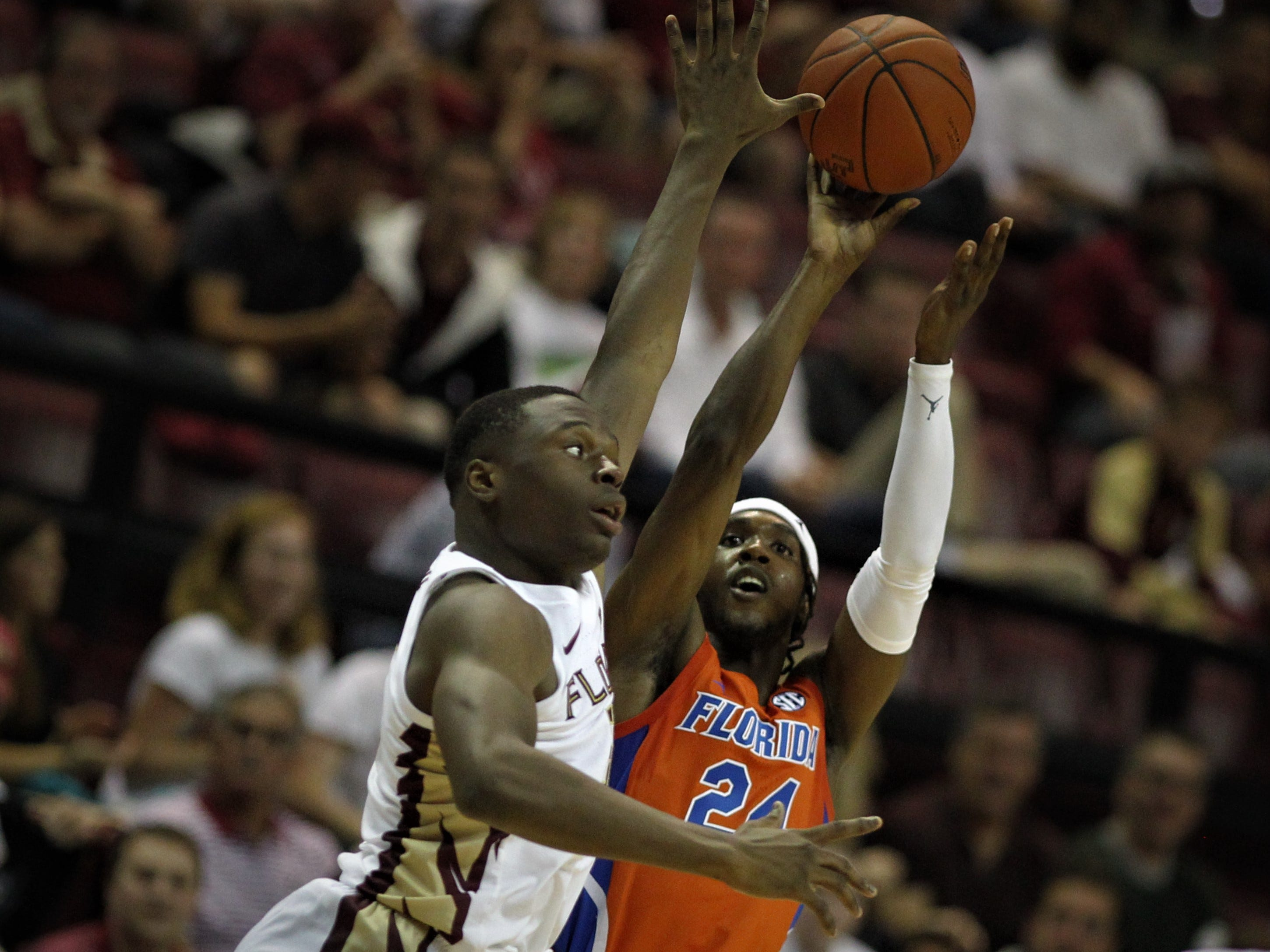 Florida State's Mfiondu Kabengele tries to disrupt the shot of Florida's Deaundrae Ballard during the Sunshine Showdown game Tuesday at the Tucker Civic Center.