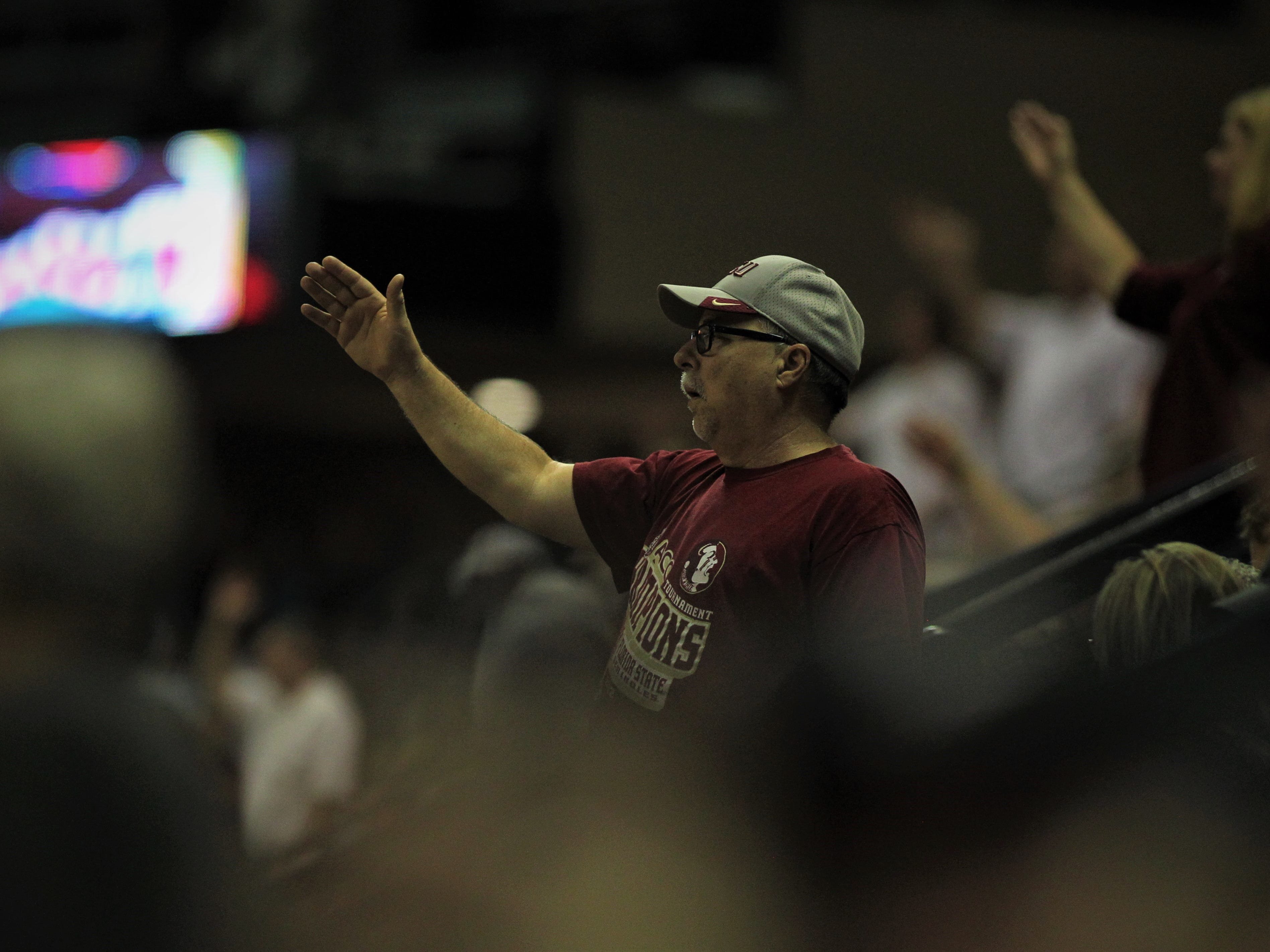 An FSU fan does the Tomahawk Chop during the Sunshine Showdown game against Florida on Tuesday at the Tucker Civic Center.