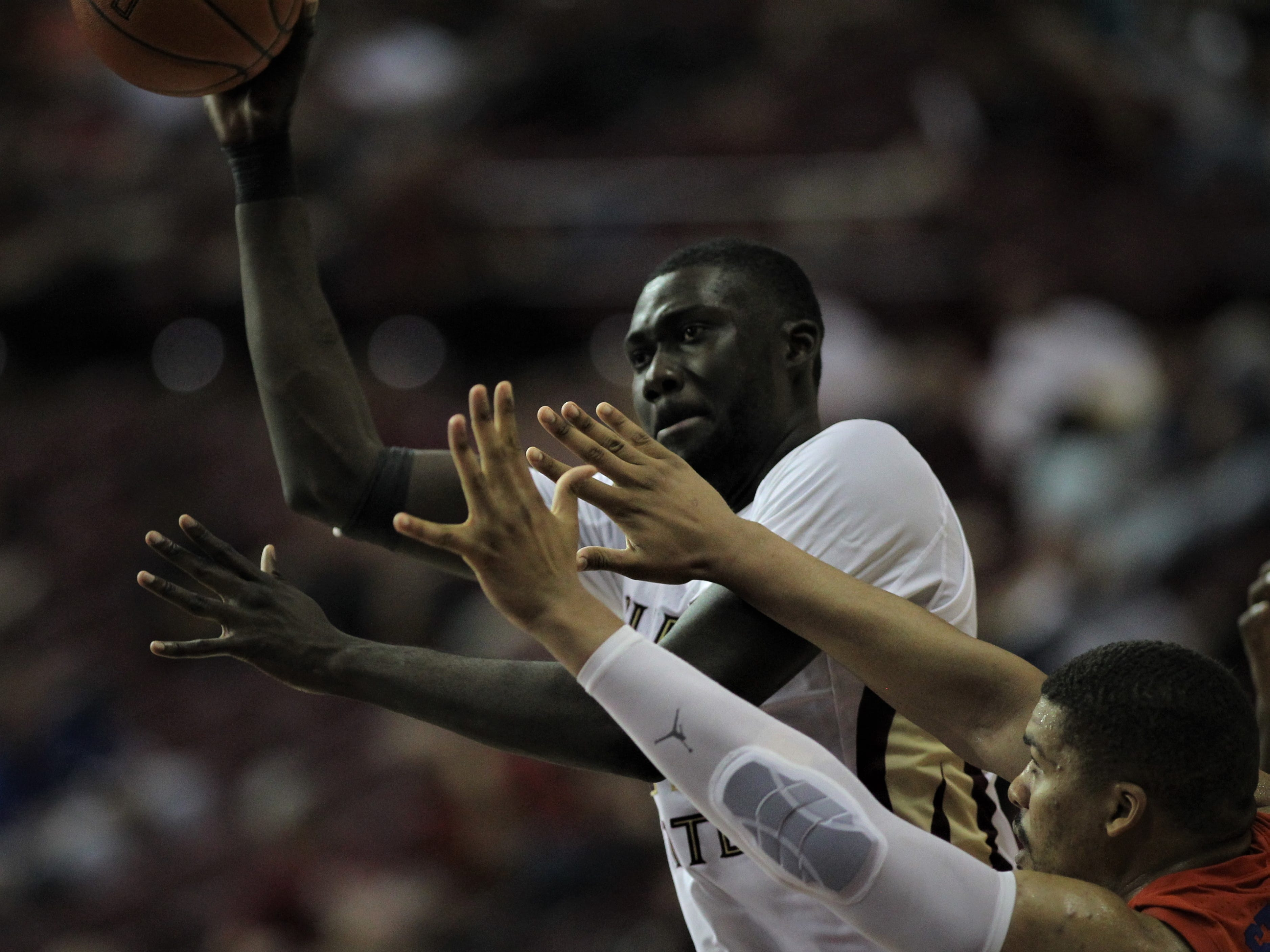 Florida State center Christ Koumadje gets off a shot against Florida during the Sunshine Showdown game Tuesday at the Tucker Civic Center.