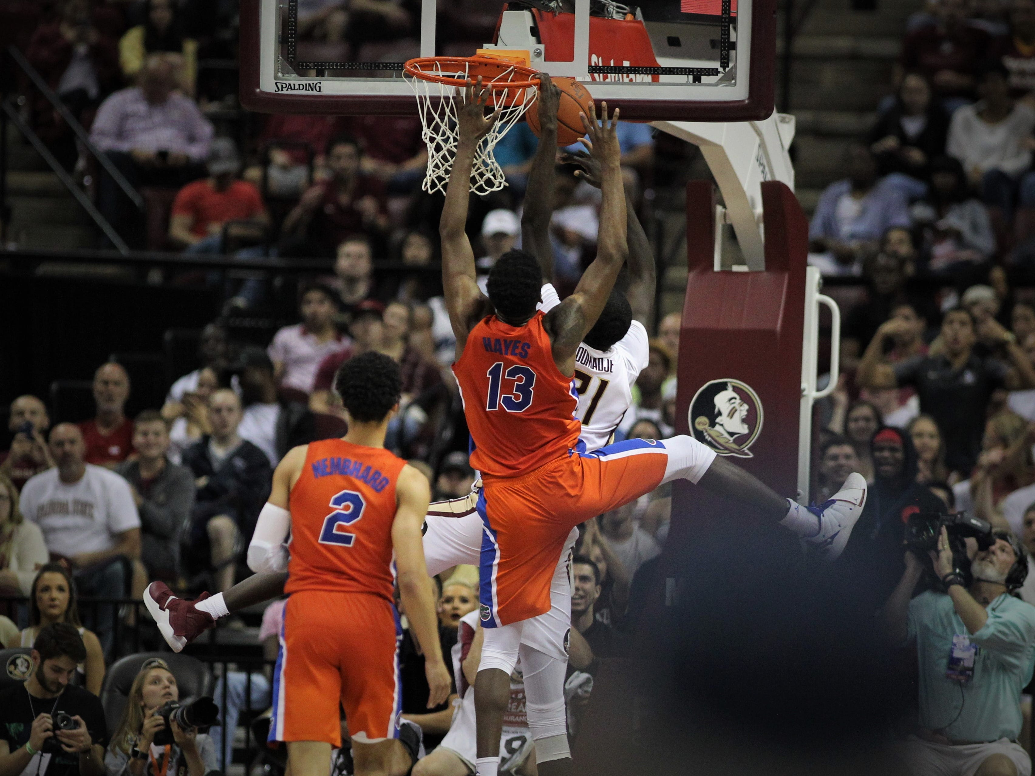 Florida State's Christ Koumadje has a shot blocked under the basket by Florida's Kevarrius Hayes during the Sunshine Showdown game Tuesday at the Tucker Civic Center.