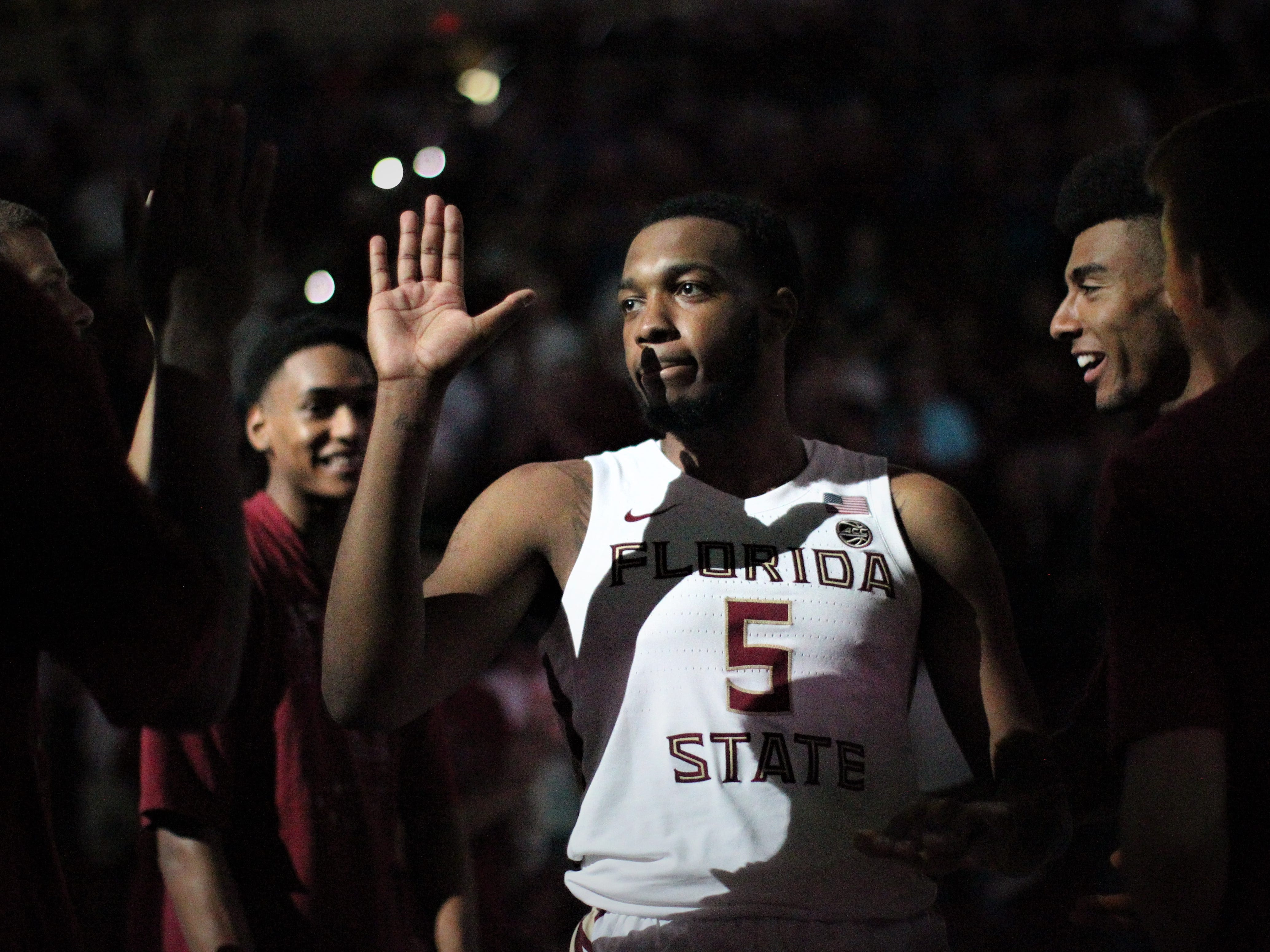 Florida State's P.J. Savoy is introduced as a starter before the Sunshine Showdown game against Florida on Tuesday at the Tucker Civic Center.
