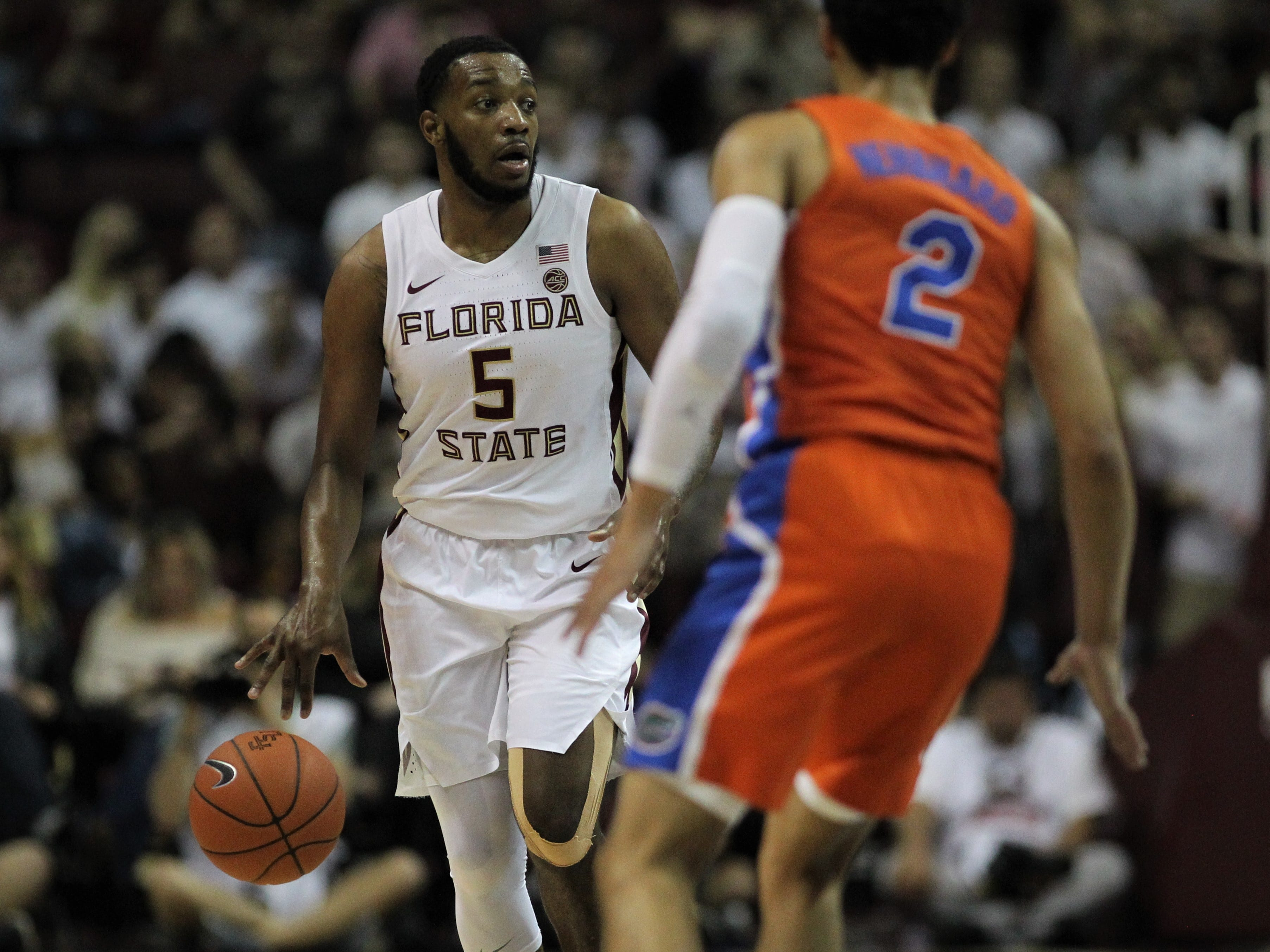 Florida State's P.J. Savoy brings the ball up the court during the Sunshine Showdown game against Florida on Tuesday at the Tucker Civic Center.