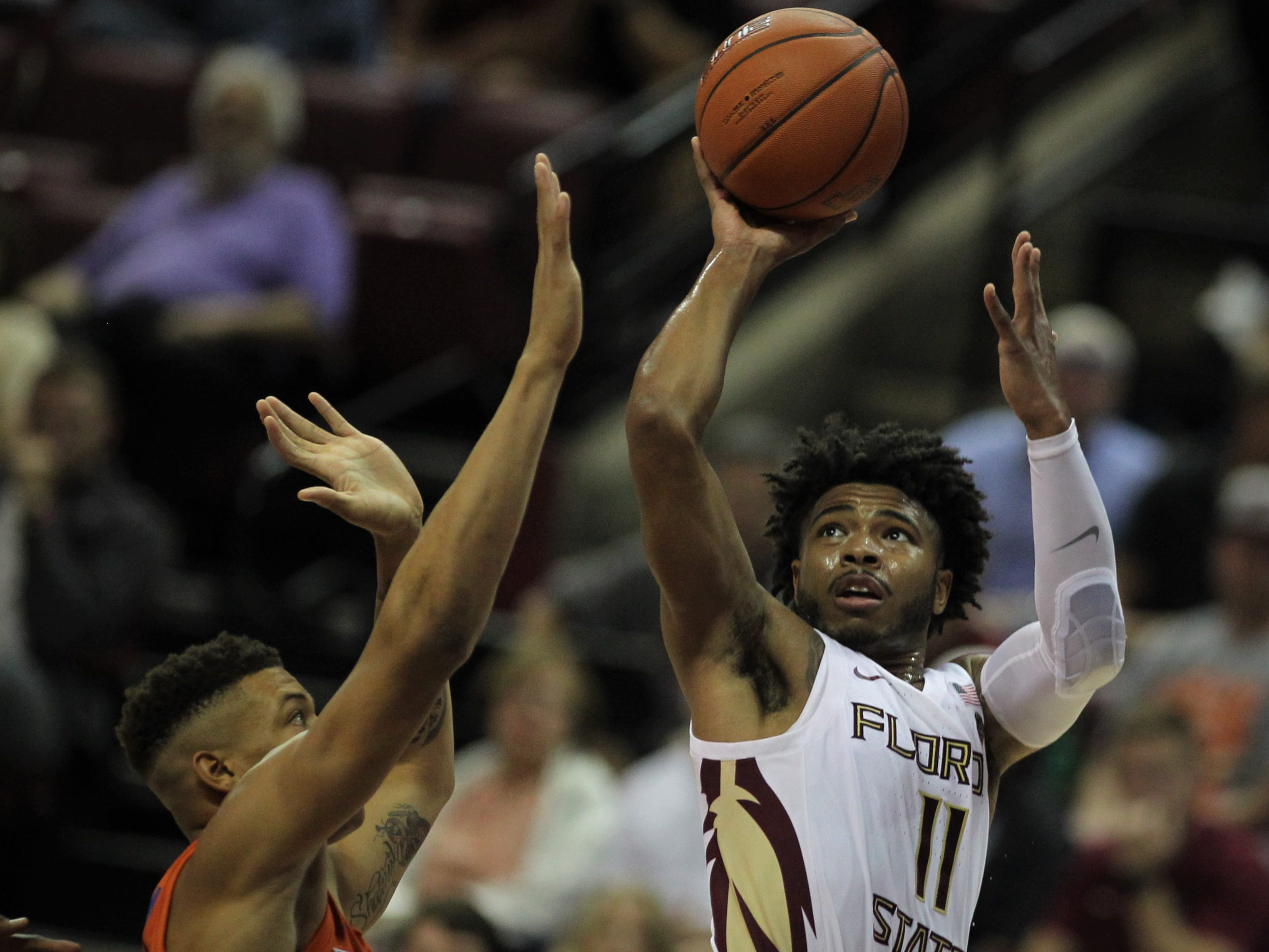 Florida State's David Nichols takes a shot over Florida's Keyontae Johnson during the Sunshine Showdown game Tuesday at the Tucker Civic Center.