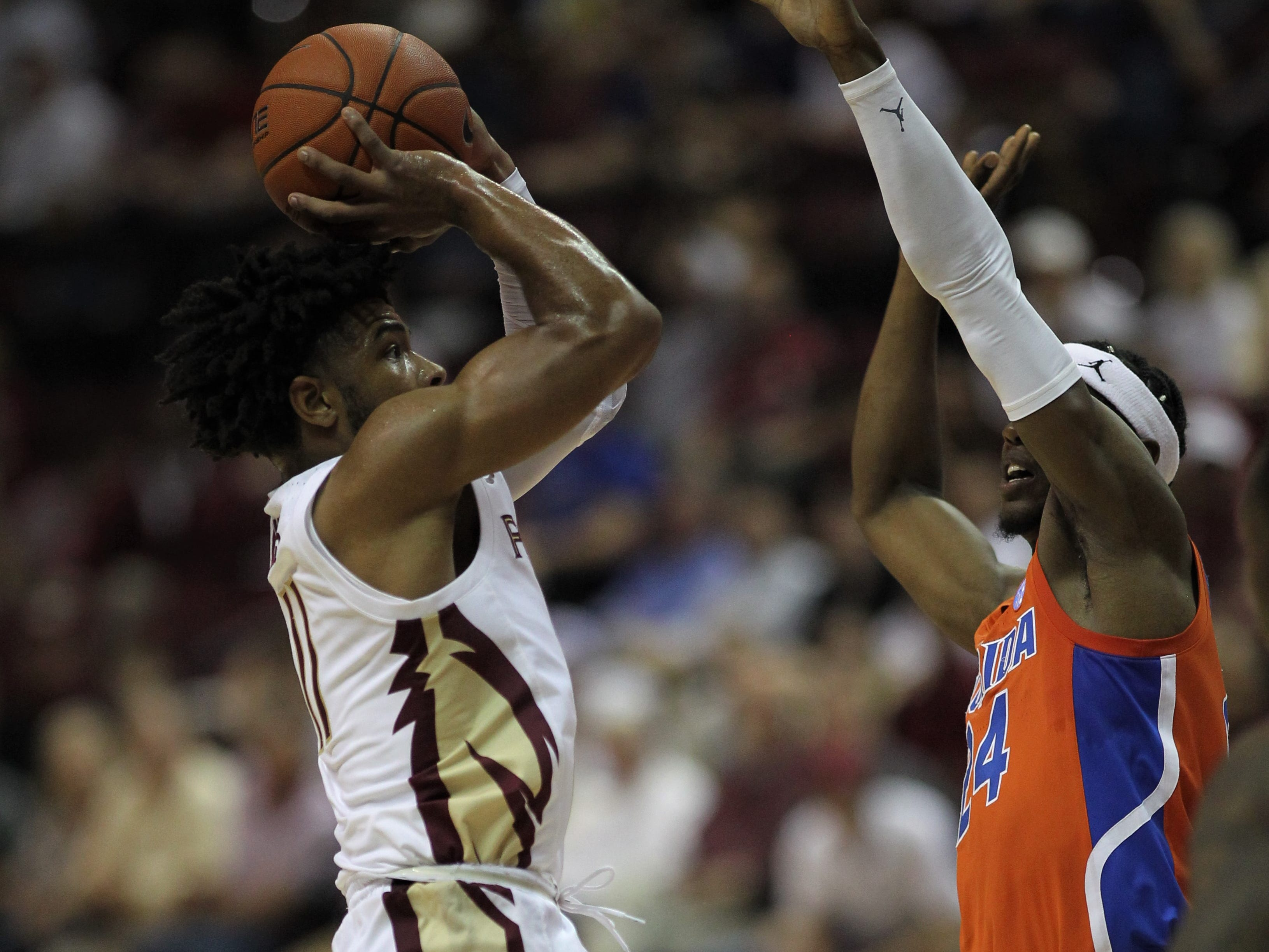 Florida State's David Nichols shoots over Florida's Daundrae Ballard during the Sunshine Showdown game Tuesday at the Tucker Civic Center.