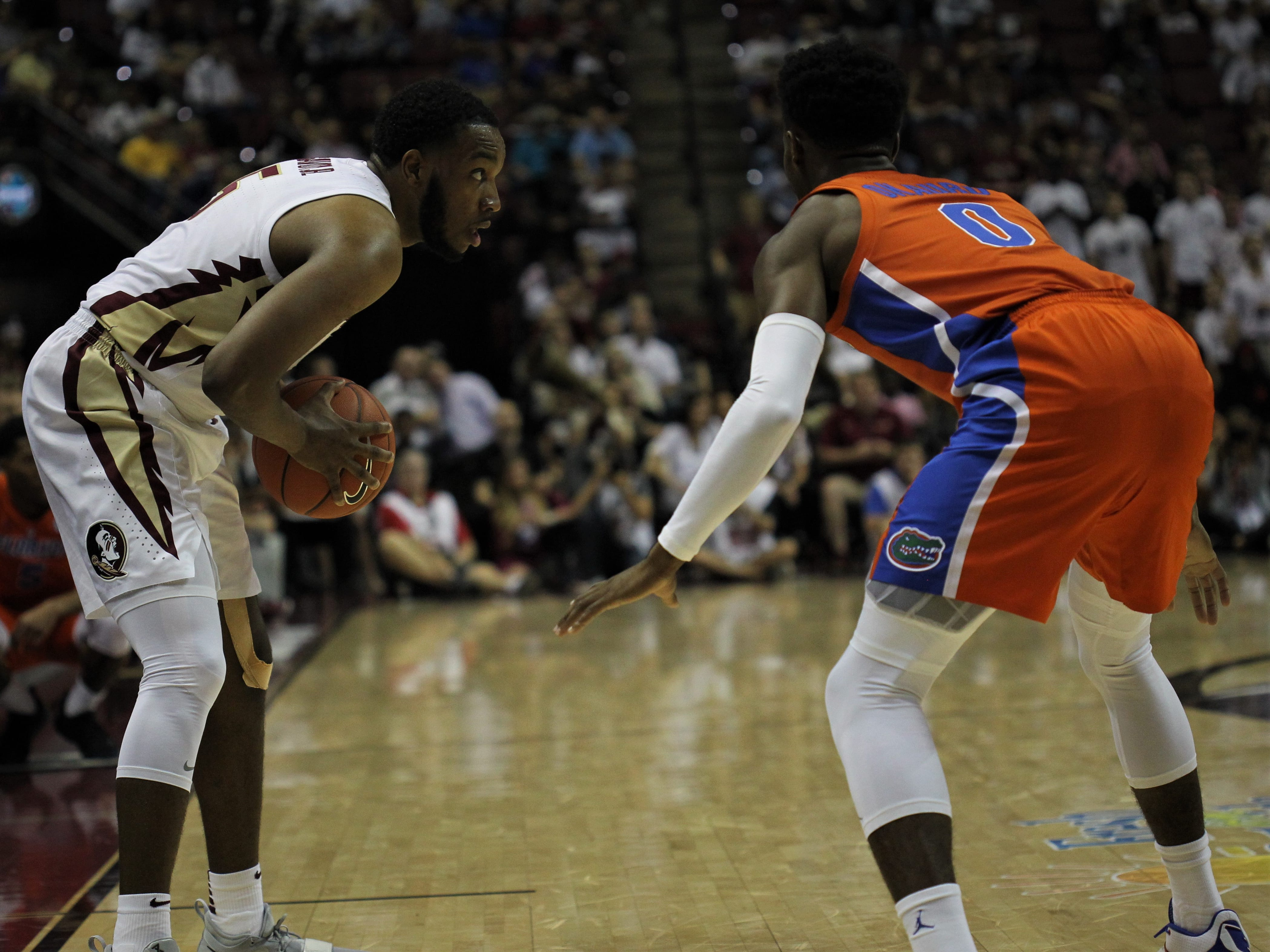 Florida State's P.J. Savoy runs his team's offense from the wing during the Sunshine Showdown game against Florida on Tuesday at the Tucker Civic Center.