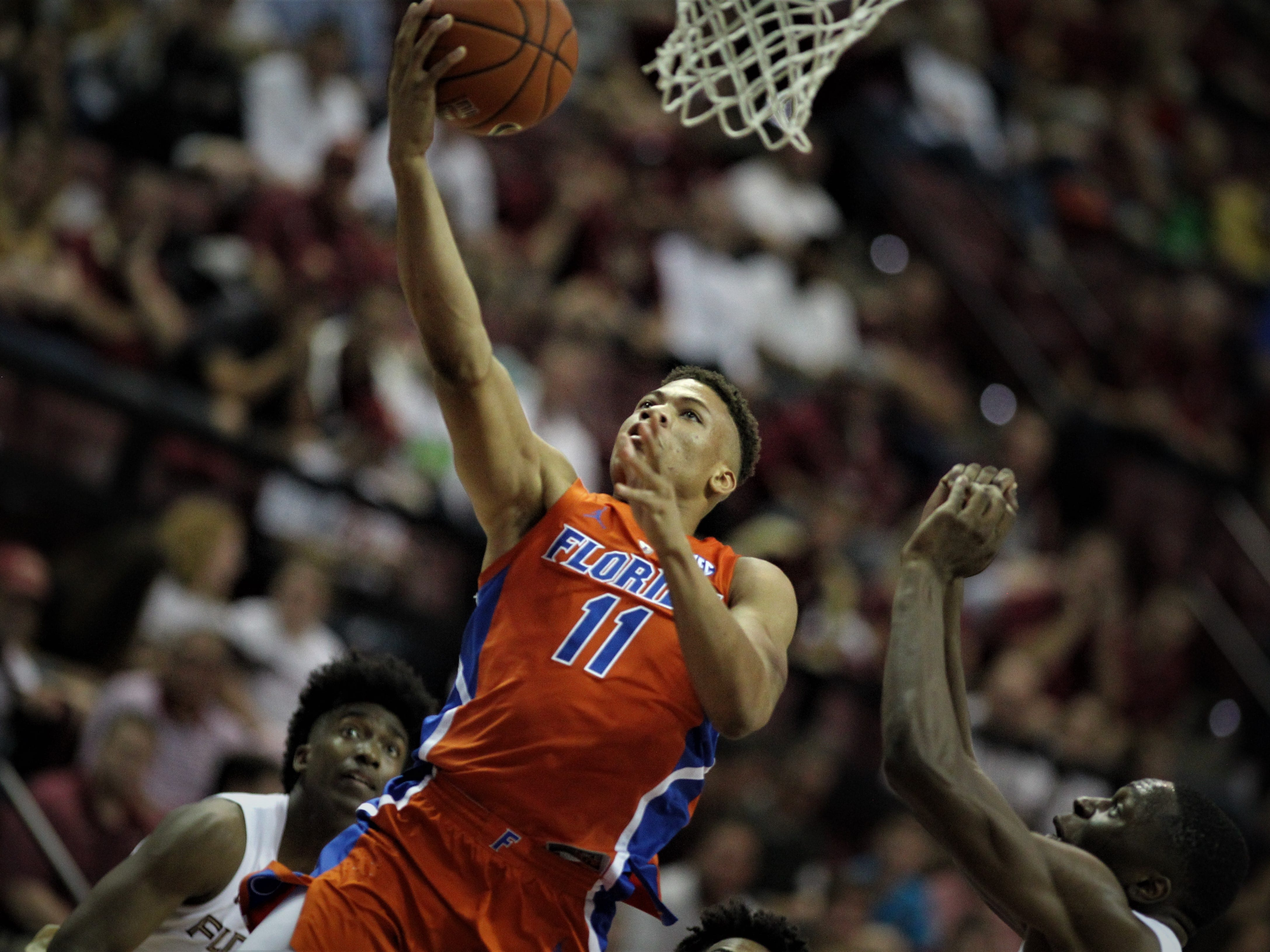 Florida's Keyontae Johnson goes up for a layup against FSU during the Sunshine Showdown game Tuesday at the Tucker Civic Center.