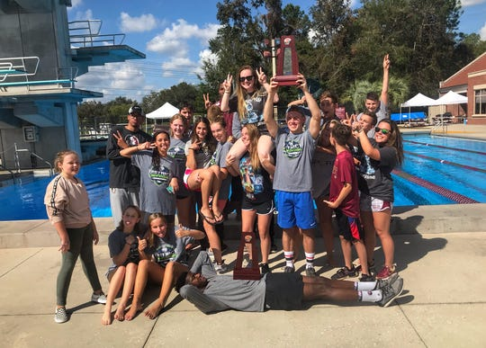 Florida High's girls and boys swimming teams celebrate District 1-1A runner-up trophies at Morcom Aquatics Center last week.