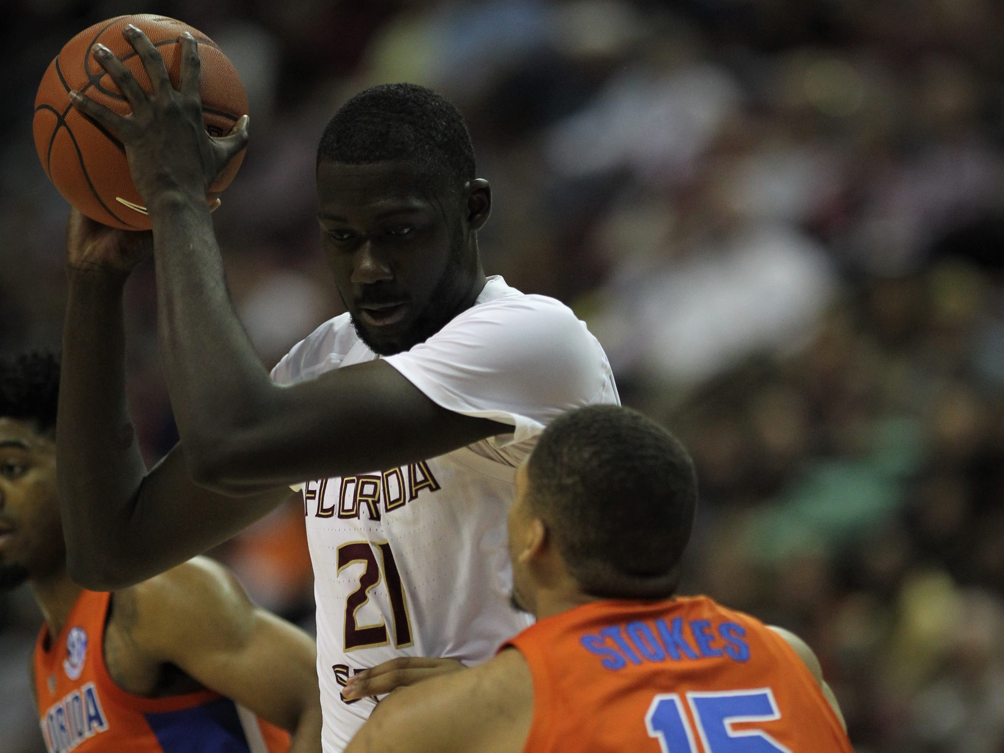 Florida State center Christ Koumadje prepares to work Florida's Isaiah Stokes during the Sunshine Showdown game Tuesday at the Tucker Civic Center.