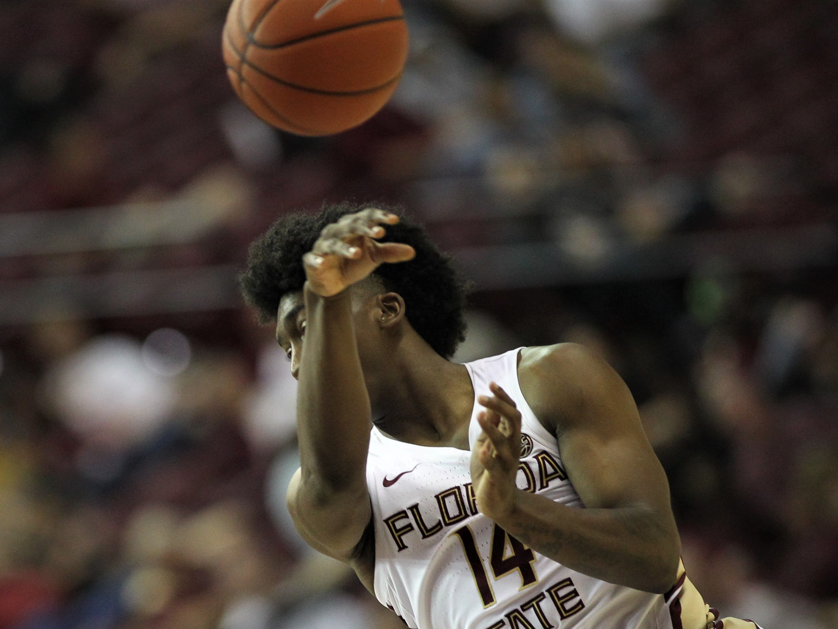 Florida State's Terance Mann throws a no-look pass during the Sunshine Showdown game against Florida on Tuesday at the Tucker Civic Center.