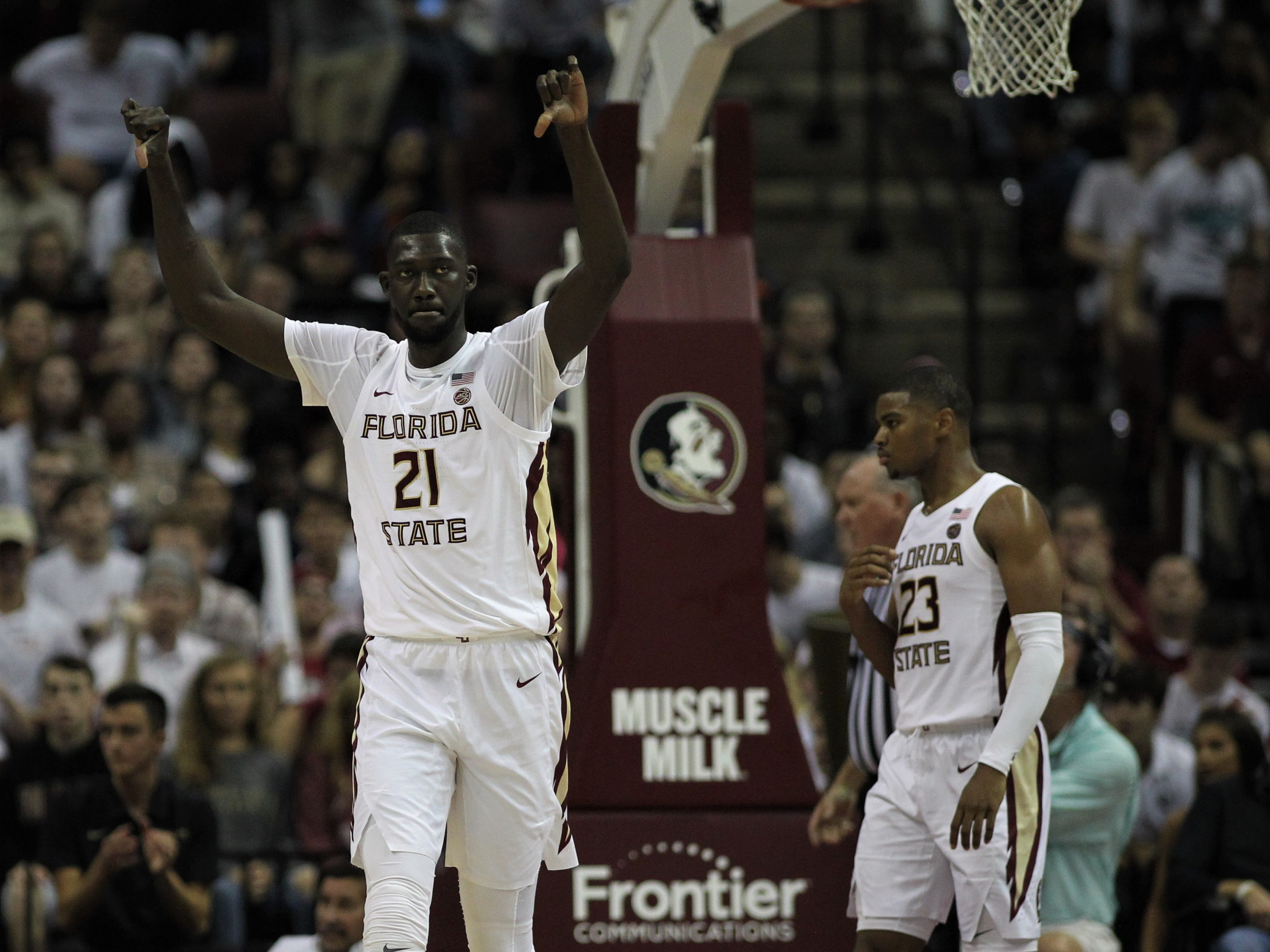 Florida State center Christ Koumadje reacts to blocking a shot during the Sunshine Showdown game against Florida on Tuesday at the Tucker Civic Center.